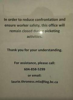 Photo of sign in from of Liberal MLA's Constituency Office