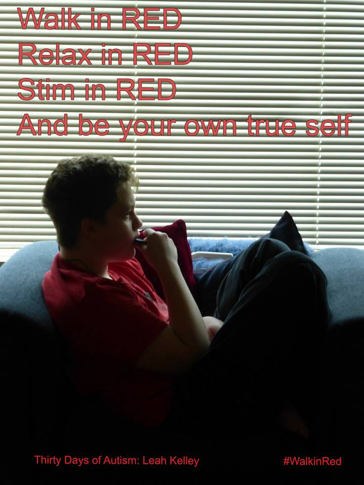 "#WalkinRed Image description: H wearing a red shirt, chewing his stim necklace, sits relaxed and curled in a large armchair. Text reads: ""Walk in RED, Relax in RED, Stim in RED, And be your own true self."""