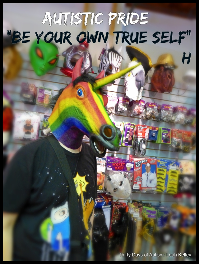 "Photos of H in a Novelty/Costume shop wearing a rainbow unicorn mask and an Adventure Time t-shirt. Text reads: Autistic Pride Day ""Be your own true self"" H (Water marked Thirty Days of Autism)"